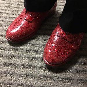 Feet wearing ruby slippers